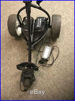 MotoCaddy S1 Electric Golf Trolley with ITE Lithium light battery on charger