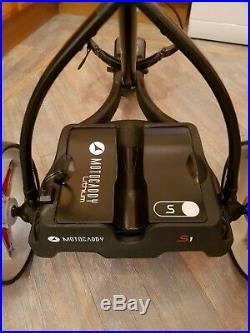 Motocaddy s1 electric golf trolley 18 hole lithium loads of accessories